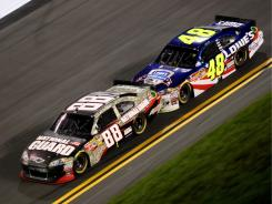 Dale Earnhardt Jr. (88) has made it known he is not a fan of this type of bump drafting he did with Jimmie Johnson (48).