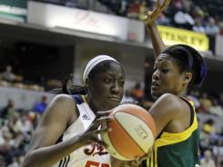 In Tuesday's win over the  Storm, the Fever's Jessica Davenport, left, led the team in points, rebounds, blocks and minutes payed.