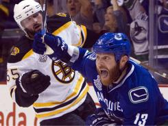 Vancouver Canucks left wing Raffi Torres celebrates after scoring the winning goal  in the dying seconds of Game 1 of the Stanley Cup Final.
