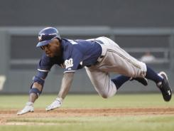 The Brewers' Nyjer Morgan steals second base June 29 against the Yankees, one of his five steals through Sunday. His inflated batting average makes him a sell-high candidate.