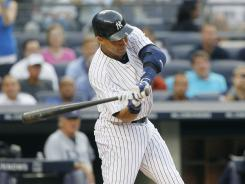 Derek Jeter strokes a first-inning double on Thursday for his 2,998th career hit.
