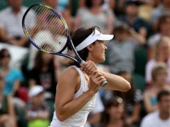 Martina Hingis of Switzerland ienjoys the team atmosphere of World TeamTennnis.