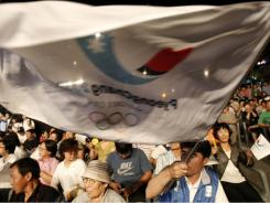 South Koreans gather to watch TV  for the International Olympic Committee's announcement of the 2018 Winter Olympic host city on Wednesday  in Chuncehon.