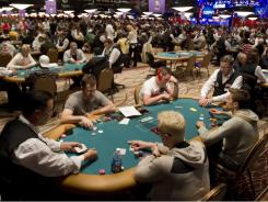Players compete in a $25,000 Heads-Up poker tournament during the World Series of Poker at the Rio hotel and casino in Las Vegas on May 31st.