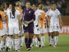 U.S. goalkeeper Hope Solo walks past team members following the Group C match against Sweden at the World Cup in Wolfsburg, Germany, on Wednesday.