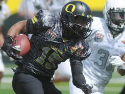 Oregon's Lache Seastrunk (15) is part of an investigation into recruiting agent Willie Lyles, who also has connections to LSU.