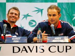 Flanked by teammate Mardy Fish, Andy Roddick fields questions after the draw ceremony for the USA's tie against Spain Friday-Sunday in Austin.