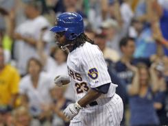 Rickie Weeks circles the bases after his three-run homer that helped the Brewers top the division-rival Reds.