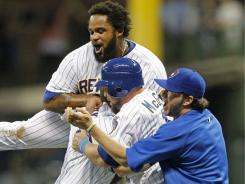 The Brewers celebrate Mark Kotsay's two-run single in the ninth inning that gave Milwaukee its third consecutive win.