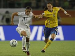 Ali Krieger, left, could be a good matchup against potent Brazil star Marta, says former Team USA player Kristine Lilly.