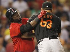 Kevin Gregg (63) and David Ortiz fight after they exchanged words during Ortiz's at-bat in the eighth inning.