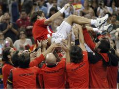 David Ferrer gets a ride as Spain celebrates its victory against the USA in Davis Cup on Sunday in Austin. David Ferrer completes Spain's victory against the USA with a four-set win vs. Mardy Fish on Sunday in Austin.