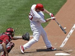 David Freese (23) hits a two-run home run in the third inning of the Cardinals' 4-2 win over the Diamondbacks on Sunday.