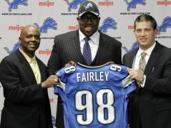 One of the key sticking points left in NFL CBA negotiations is how much rookies, like Lions  first-round pick Nick Fairley, seen here with team general manager Martin Mayhew, left, and head coach Jim Schwartz in April, will get paid.