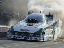Mike Neff powers his Ford Mustang at 293.22 mph to defeat Jeff Arend in the Funny Car finals at Route 66 Raceway.