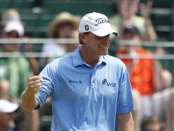 Steve Stricker celebrates his birdie on the ninth green Sunday en route to his third consecutive victory in the John Deere Classic at TPC Deere Run Silvis, Ill.