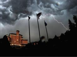 Lightning strikes cause a weather delay during the final round of the U.S. Women's Open at The Broadmoor on Sunday in Colorado Springs.