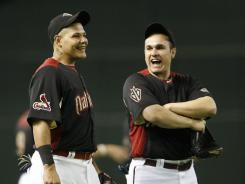 Diamondbacks catcher Miguel Montero, right, with Cardinals catcher Yadier Molina, replaced injured Phillies third baseman Placido Polanco on the National League All-Star roster.