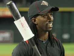 Andrew McCutchen warms up for batting practice at Chase Field.