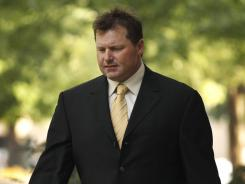 Roger Clemens arrives at federal court in Washington on Monday. Clemens' attorney hinted the former MLB pitcher may not testify in his perjury trial.