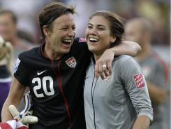 Abby Wambach, left, and goalkeeper Hope Solo celebrate winning the quarterfinal match against Brazil at the World Cup on July 10 in Dresden.