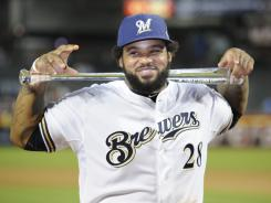 Prince Fielder, whose three-run homer was the All-Star Game's key blow, poses with the MVP award.