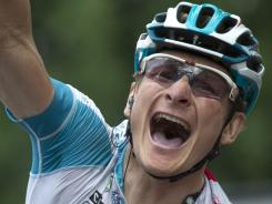 Andre Greipel celebrates at the finish line as he wins the  10th stage of the 2011 Tour de France.