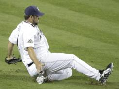 Padres pitcher Heath Bell slides in the infield before pitching in the eighth inning of Tuesday's All-Star Game.