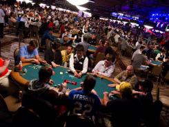 Players compete on the first day of the World Series of Poker,