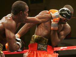 Erislandy Lara, left, connects on one of his overhand lefts against Paul Williams Saturday night. Despite connecting on a much higher percentage of punches, Lara lost a controversial majority decision.