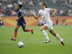 Alex Morgan prepares to score her side's third goal during the semifinal match between France and the United States at the Women's World Cup in Moenchengladbach, Germany, on July 13. The USA won 3-1.