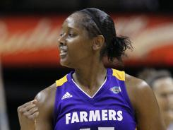 Noelle Quinn celebrates after the Sparks beat the Silver Stars 84-74 Tuesday. It was the team's first win under head coach Joe Bryant, father of Lakers' Kobe Bryant.