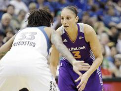 Mercury guard Diana Taurasi, right, looks to drive past Lynx guard Seimone Augustus during Phoenix's 112-105 win in Minneapolis.