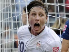 Abby Wambach celebrates after scoring the USA's second goal  during its semifinal match against France on Wednesday.