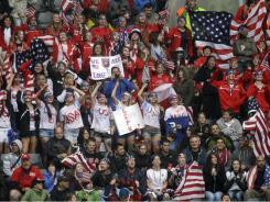 United States fans cheer from the stands during the semifinal match between France and the USA in Moenchengladbach, Germany, on July 13. The USA won 3-1.