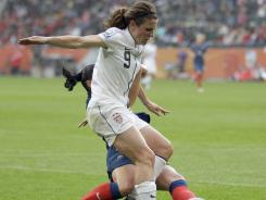 Heather O' Reilly competes for the ball during the semifinal match against France at the World Cup in Moenchengladbach, Germany, on July 13.