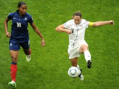 U.S. defender Christie Rampone fights for the ball with France's striker Marie-Laure Delie during their World Cup semifinal match in Moenchengladbach, Germany, on July 13.