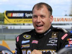 Ryan Newman flashes a grin after winning the pole at Friday's qualifying for Sunday's Sprint Cup race at New Hampshire Motor Speedway.