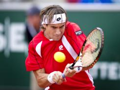 Spain's David Ferrer cruised past Andreas Haider-Maurer of Austria  6-1, 6-1 to reach the semifinals.