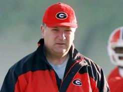 Documents claim former Georgia head coach Jim Donnan, who was fired in 2000, made $14.5 million from a Ponzi scheme.
