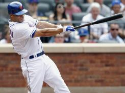 Mets' Scott Hairston hits a double to drive in two of his five RBI against the Phillies Saturday.