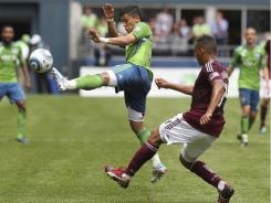 Sounders' Fredy Montero, left, scored one goal and assisted another in the waning minutes Saturday to give Seattle the win.