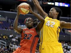 Washington Mystics guard Matee Ajavon (22) scores on Los Angeles Sparks center Jantel Lavender.