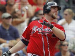 Atlanta Braves' Brian McCann hits a three-run homer Sunday in a win over the Nationals.