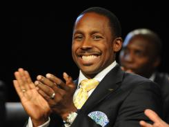 Desmond Howard, who electrified crowds while playing at Michigan from 1989-91, reacts to a comment during the College Football Hall of Fame Enshrinement show on Saturday in South Bend, Ind.