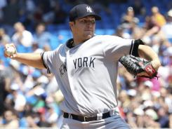 Yankees' Phil Hughes won his first game of the season.