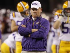 LSU coach Les Miles watches his team during warmups prior to the 2011 Cotton Bowl against Texas A&M.