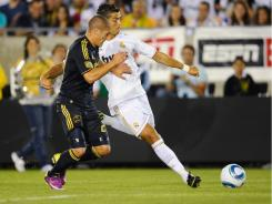 Cristiano Ronaldo, right, of Real Madrid, scores against the L.A. Galaxy in a friendly Saturday.