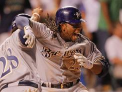Rickie Weeks of the Milwaukee Brewers celebrates his two-run go-ahead homer in the ninth inning off of Rockies' closer Huston Street.
