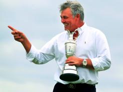 Darren Clarke pof Northern Ireland continues the celebration that started Sunday night on Monday morning, the day after he won the Claret Jug.